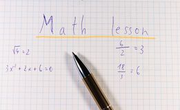 A title of square paper with golden pen. Title is math lesson because school is here. And new beginning to find some friends stock photo