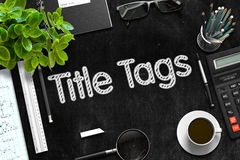 Title Tags on Black Chalkboard. 3D Rendering. Top View of Office Desk with Stationery and Black Chalkboard with Business Concept - Title Tags. 3d Rendering Stock Images