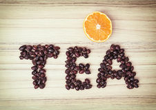 Title TEA composited of the dried rosehips with sliced orange Stock Photo