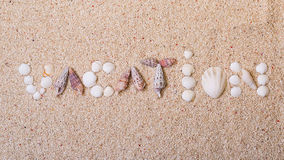 Title vacation from sea shells Royalty Free Stock Photos