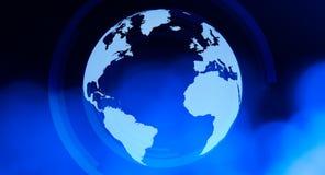 Title World globe background. World globe and blue defocused background Royalty Free Stock Images