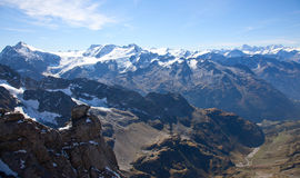 Titlis in Switzerland Alps. Standing Titlis Peak overlooking the surrounding Royalty Free Stock Images