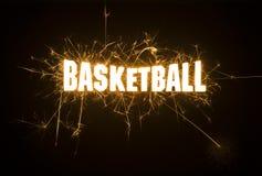 Titolo del titolo di pallacanestro in scintille su fondo scuro Fotografia Stock Libera da Diritti