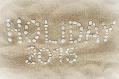 Titolo di festa 2015 composto di ciottoli bianchi della spiaggia Fotografia Stock