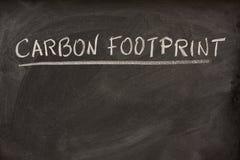 Titolo di orma del carbonio su una lavagna fotografia stock libera da diritti