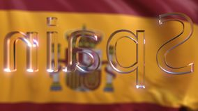 Titolo di vetro girante della Spagna contro la bandiera d'ondeggiamento dello Spagnolo stock footage