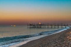 Titreyengol anterior de la playa de la salida del sol o de la puesta del sol Foto de archivo libre de regalías