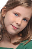 Tittle girl's portrait. Isolated on a white background Royalty Free Stock Photos