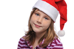 Tittle girl's portrait. Wearing a Santa's hat isolated on a white background Royalty Free Stock Photos