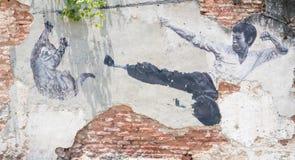 Tittle mural de la calle pintado por Ernest Zacharevic en Penang Imagenes de archivo