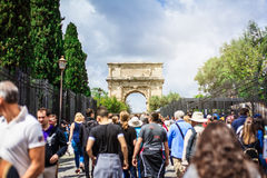 Titus arch in Roman Forum. Rome, Italy. ROME, ITALY - APRIL 23 2016: Tourists walking in Via Sacra of Rome, with the Arch of Titus in the background, on April Royalty Free Stock Photos