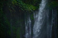 Tiu Kelep Waterfall near Rinjani, Senaru Lombok indonesia. Southeast Asia. Motion blur and soft focus due to Long Exposure Shot. Tiu Kelep Waterfall near stock image