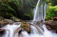 Tiu Kelep Waterfall near Rinjani, Senaru Lombok indonesia. Southeast Asia. Motion blur and soft focus due to Long Exposure Shot. Tiu Kelep Waterfall near stock photos