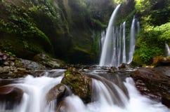 Tiu Kelep Waterfall near Rinjani, Senaru Lombok indonesia. Southeast Asia. Motion blur and soft focus due to Long Exposure Shot. Tiu Kelep Waterfall near royalty free stock photo