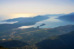 Tivat airport and town and Adriatic sea. View of Kotor bay, Tivat city and Adriatic sea royalty free stock photos