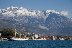 Tivat bay with sailboat and hill Royalty Free Stock Photography