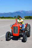 TIVAT, MONTENEGRO-28 AUGUSTUS. retro a mini tractor is used for Stock Photos