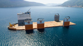 Tivat, Montenegro - 31 July 2017: Heavy lift vessel Dockwise Vanguard came to Montenegro to take the floating dock. And take it to Lithuania royalty free stock photos