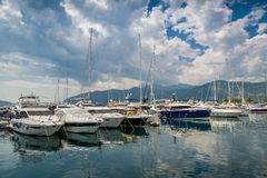 Tivat yacht marina. Mediterranean yacht marina full of sailing boats. Cloudy sky and yacht reflections on the water. Tivat, Montenegro Royalty Free Stock Image