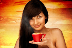Tive young woman with black hair holding red cup of coffee in he Stock Photos