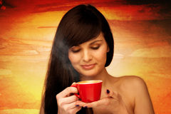 Tive young woman with black hair holding red cup of coffee in he Stock Images
