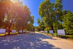 Tivoli park and in Ljubljana walkway in red sun haze view. Capital of Slovenia Royalty Free Stock Image