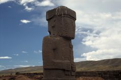 Tiwanaku - Bolivia. An immense statue evokes the sacred beliefs of the people who inhabited the ancient city Tiwanaku Stock Image