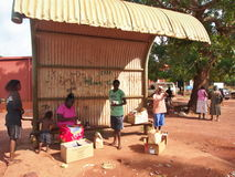 Tiwi People Waiting On The Bus Stop Royalty Free Stock Photos