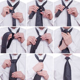 Tiying a tie with a windsor knot Stock Photo