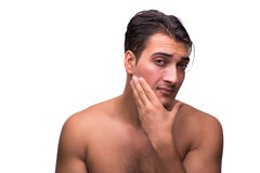 The tiyng man after shaving isolated on white Royalty Free Stock Image