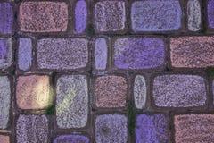 Tiza coloreada en el pavimento Imágenes de archivo libres de regalías