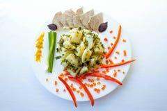 """Tjänad som lunch- eller matställe†""""lät småkoka potatisen med köttskivor Royaltyfri Foto"""