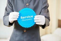 Tjänste- garanti i ett hotell Arkivfoto