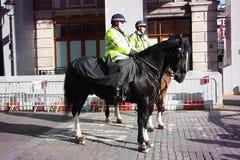 Tjänstemän för Skottland gård på hästar Arkivfoton