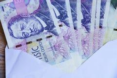 Tjeckiska pengar i kuvert Royaltyfria Foton