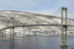 The Tjeldsund suspension road Bridge in winter crossing the Tjeldsundet strait, Troms county, Norway. Royalty Free Stock Photos