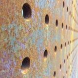 Tjocka Rusty Metal Plate med hål Royaltyfria Foton