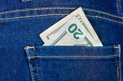 Tjugo dolars inom av jeansbakfickan Royaltyfri Bild