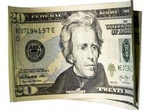Tjugo dollarräkningar som isoleras på vit Arkivfoton