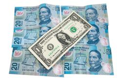 Tjugo pesos och en dollar royaltyfri bild