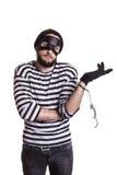 Tjuv som följaktligen arresteras av hans brott Arkivbild