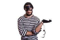 Tjuv som följaktligen arresteras av hans brott Arkivfoto