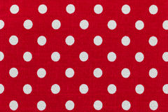 Tkanina z czerwonym i białym polek kropek wzorem Fotografia Stock