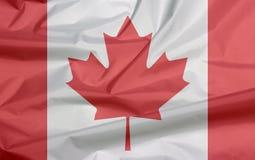 Tkaniny flaga Kanada Zagniecenie kanadyjczyk flaga tło fotografia stock