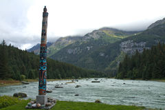 Tlingit totem on the Chilkoot River, near Haines, AK Royalty Free Stock Image