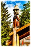 Tlingit Totem. Ketchikan, AK, USA - May 24, 2016: Native American Totems and Clan Houses located at Totem Bight State Historic Site stock photography