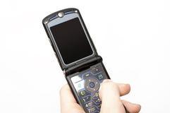 Téléphone portable de chiquenaude Images libres de droits