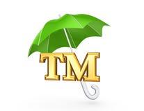 TM symbol under green umbrella. Royalty Free Stock Photos