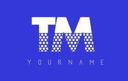 TM T M Dotted Letter Logo Design con el fondo azul Imagen de archivo libre de regalías