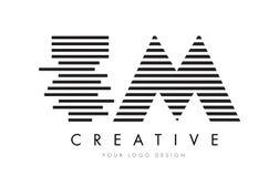 TM T M Zebra Letter Logo Design with Black and White Stripes Stock Photos